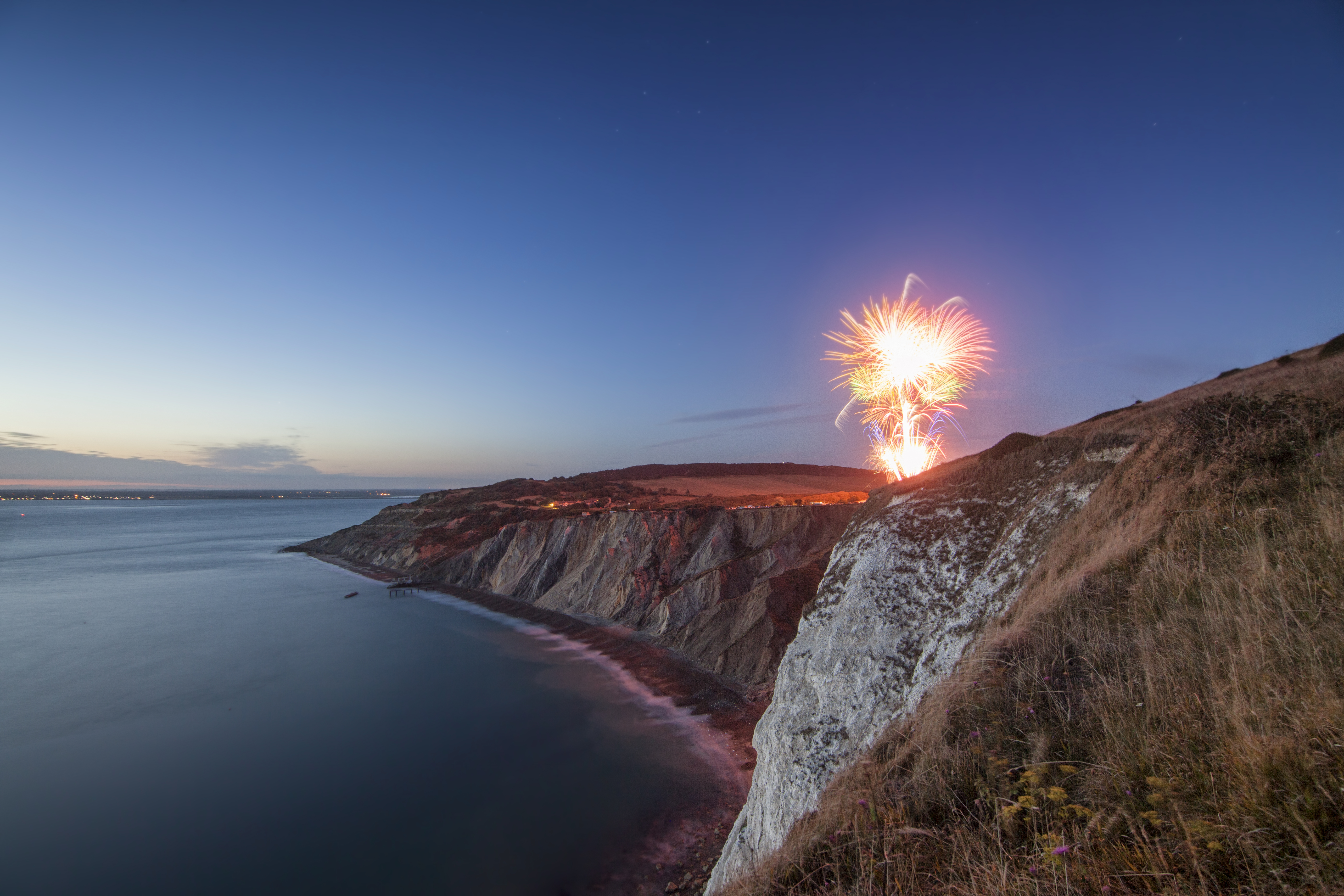 fireworks on cliff above alum bay